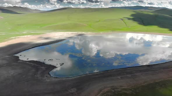 Lake in The Middle of The Treeless Meadow with Aerial View