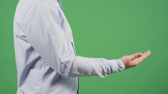 """Thumbnail for Side view of a man showing """"come here"""" sign"""