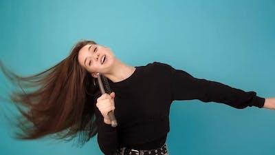 Model Sings Into Hairbrush As Microphone