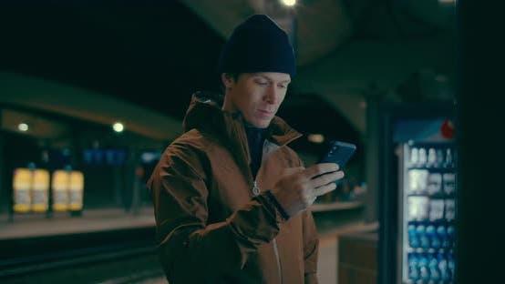 Midnight Commuter Wait for Train on Dark Platform