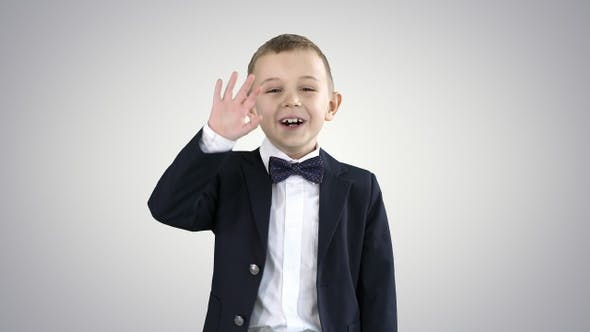 Thumbnail for Friendly little boy in a suit says hi and then says bye