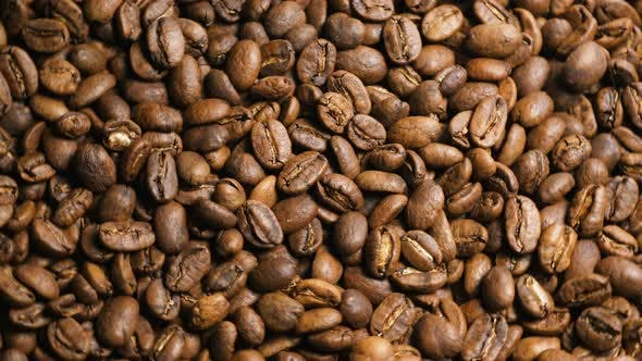 Thumbnail for Camera Rotates Above Pile of Aromatic Roasted Coffee Beans