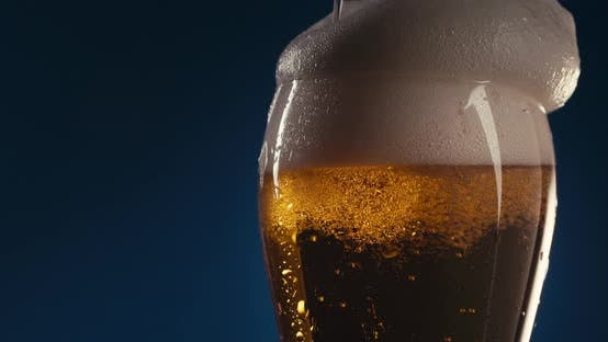 Cover Image for Overfilling A Glass With Beer