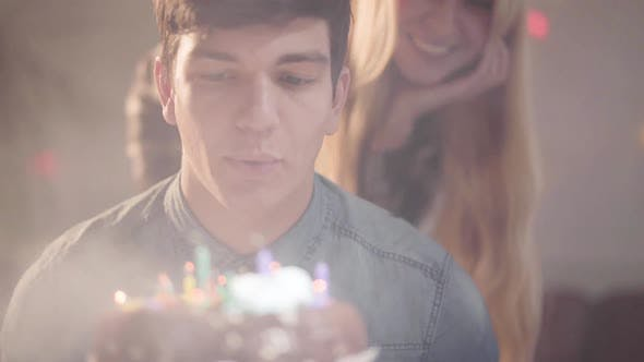 Thumbnail for Portrait Handsome Guy Blowing the Candles on the Cake