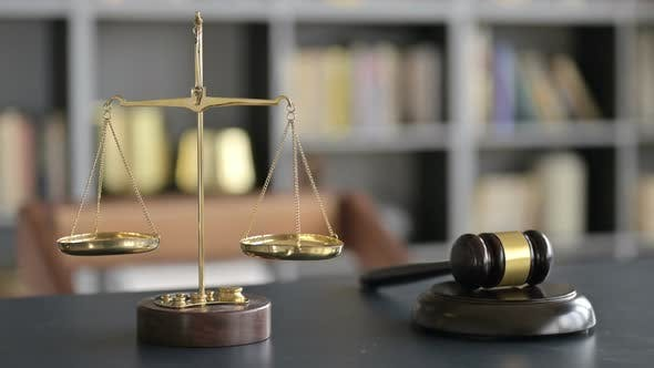 Thumbnail for Gavel and Gold Brass Balance Scale on Lawyer Office Table