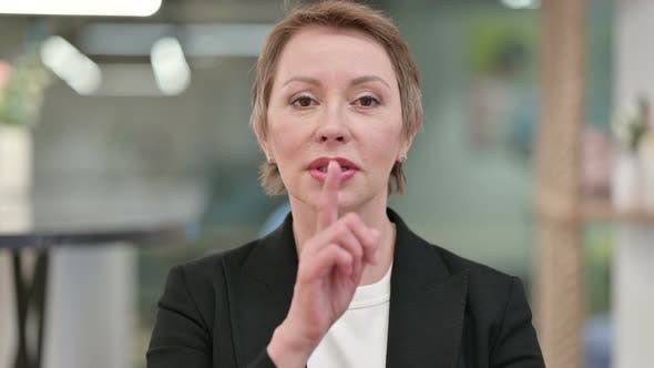 Thumbnail for Old Businesswoman Putting Finger on Lips, Quiet Sign