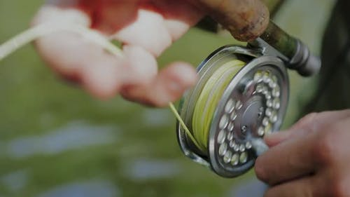 Fisherman Using Fishing Line Spool