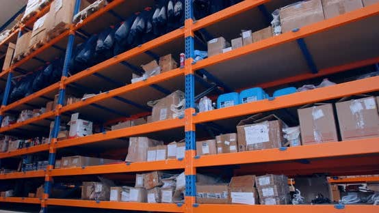 Footage of the Full Shelves of a Storehouse, Shelves with Goods,