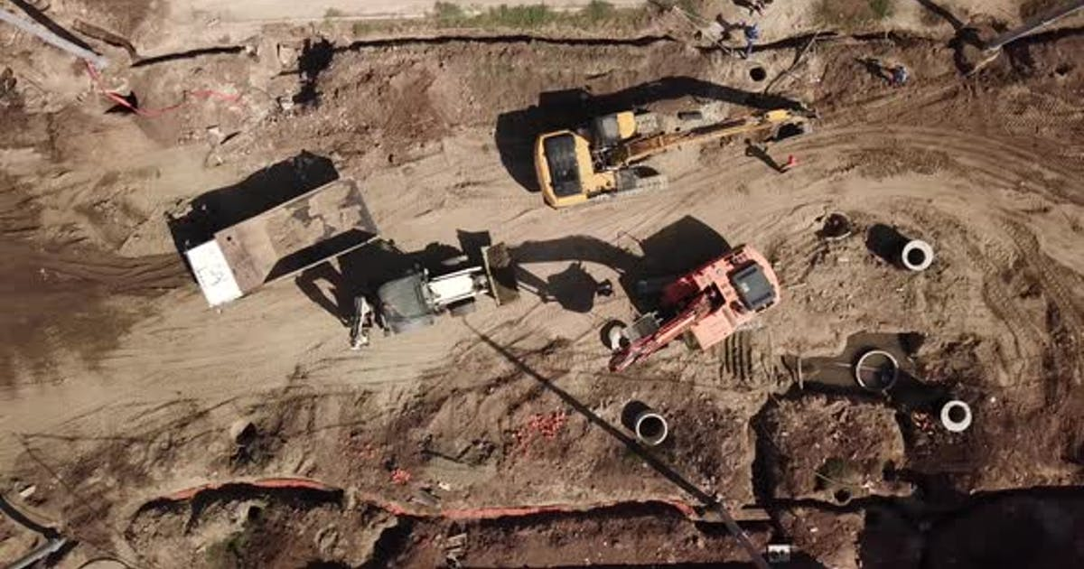 Aerial Construction Site with Machinery, Bulldozer, Excavation