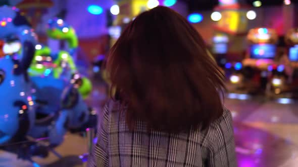 Thumbnail for A Young Woman Is Walking in an Amusement Park. The Camera Follows the Girl. Park for Children with