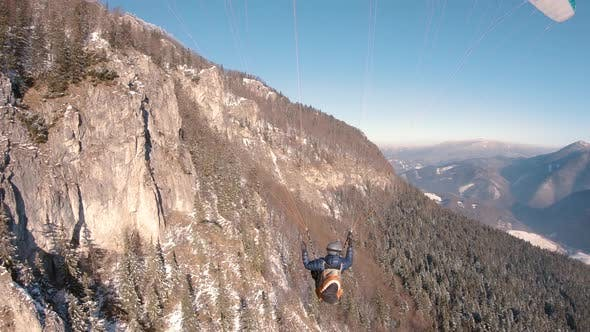 Paragliding Flight by Rocky Mountain in Forest Nature Landscape in Early Spring Adrenaline Extreme