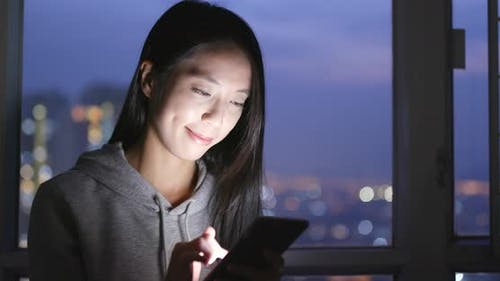 Young Woman Use of Smart Phone at Home