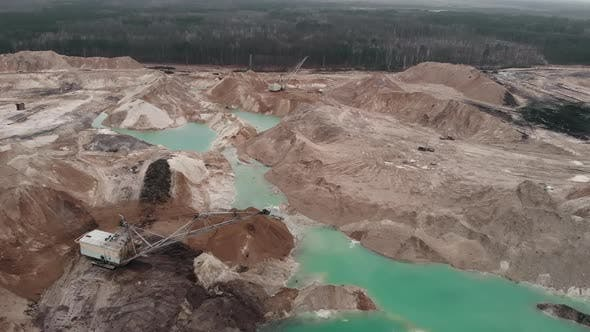 Thumbnail for Giant excavator works at sand quarry. Excavators are loading sand
