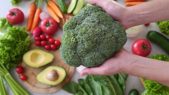 Thumbnail for Broccoli In Hands. Healthy Eating Concept.