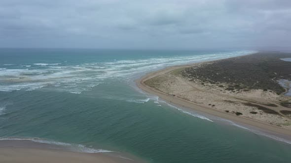 Thumbnail for Aerial footage of people fishing at the mouth of the River Murray in regional Australia