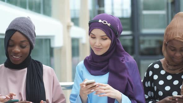 Thumbnail for Couple Young Business Muslim Female Using Smart Phone Contact with Partner