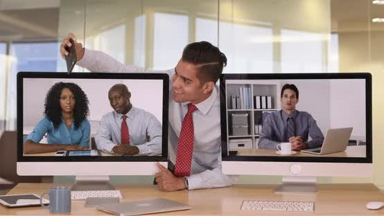 Thumbnail for Businessman with same tie as colleague on video conference taking selfie with smartphone