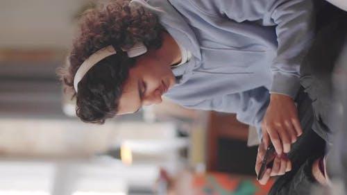 Teen Boy Enjoying Mobile Game on Smartphone