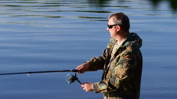 Thumbnail for Fisherman Holds a Fishing Rod in His Hand and Catches Fish for Bait