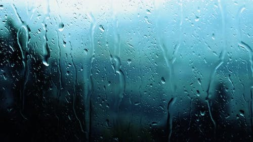 The background of the rain outside the window, raindrops, a beautiful splash of water