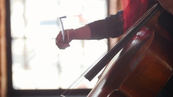 Thumbnail for A Woman Playing the Cello in the Studio
