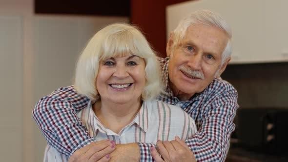 Thumbnail for Senior Family Couple Hugging, Laughing, Smiling Looking at Camera During Coronavirus Lockdown