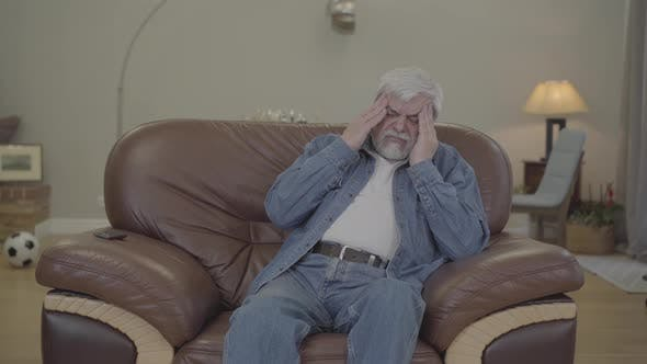 Thumbnail for Attentive Adult Son Bringing Pills and Water To Senior Father Having Headache. Young Caucasian Man