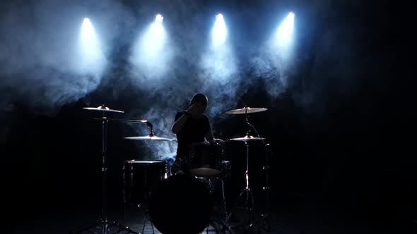 Thumbnail for Energetic Musician Plays Good Music on Drums. Black Smoky Background, Back Light, Silhouette