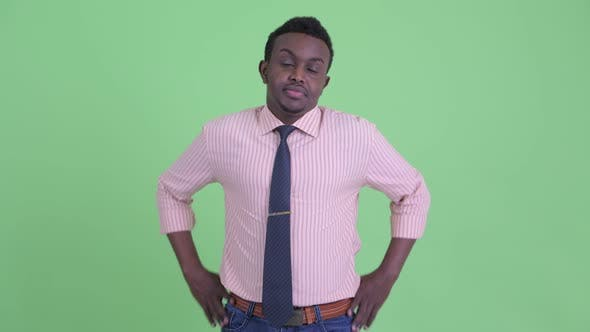 Stressed Young African Businessman Looking Bored and Tired