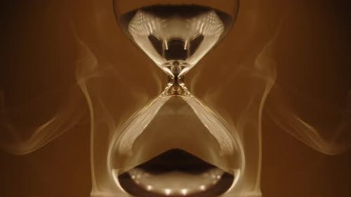 Abstract hourglass on golden background