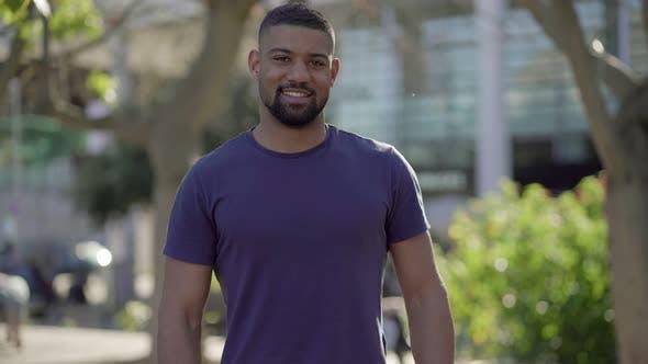Thumbnail for Medium Shot of Young Man in Park Looking at Camera, Smiling