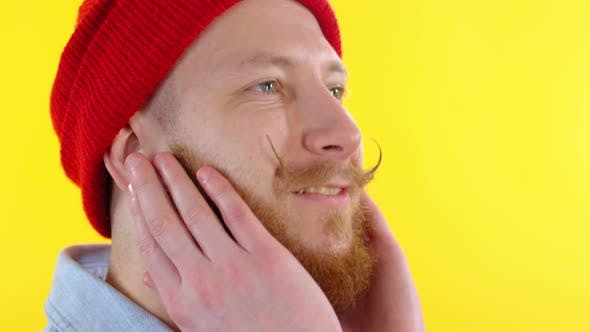 Thumbnail for Face of Bearded Man Listening to Music