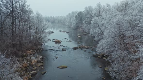 Thumbnail for Drone Flight Over the River in Winter