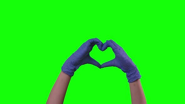 Female Doctor Making Heart Shape with Her Hands, Green Screen