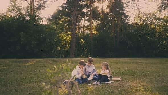 Schoolboys Prepare for Exams with Little Girl in Garden