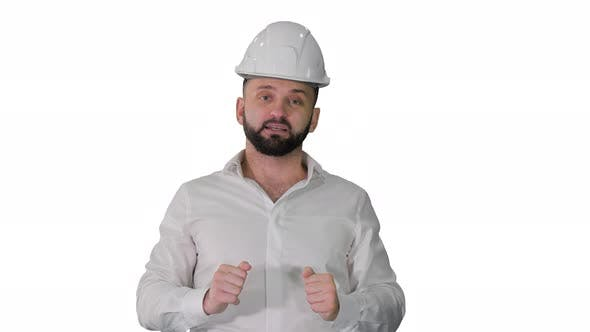 Engineer in a White Helmet Explaining Something To Camera on White Background.