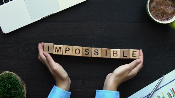 Thumbnail for Impossible to Possible Hand Putting Word of Cubes