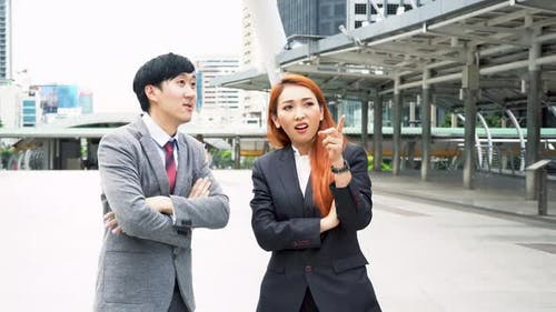 Young Asian Business Man Discussing with Business Woman