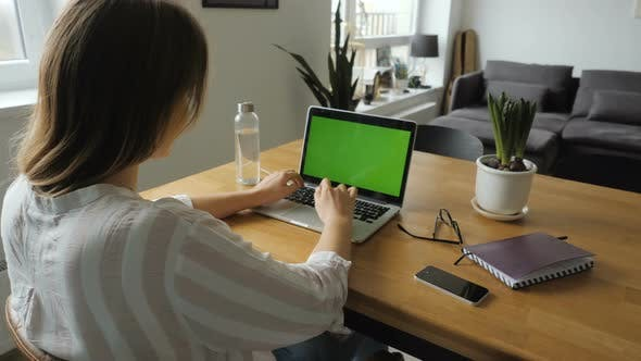 Thumbnail for Woman Working With Green Screen Laptop