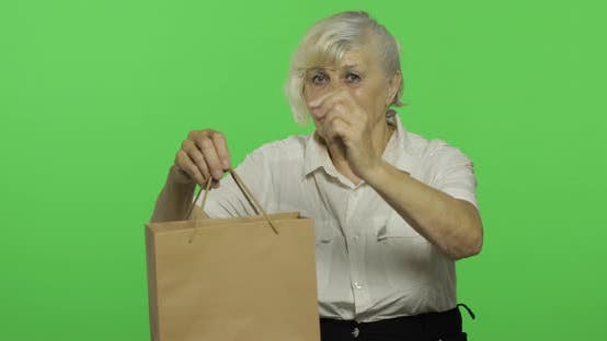 Thumbnail for An Elderly Woman with Shopping Bag. Shopping. Presents. Chroma Key