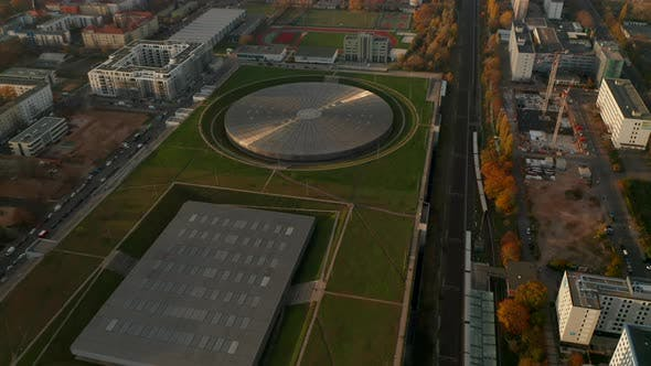 Establishing Aerial Shot Above Futuristic Velodrome Building Cycling Arena in Berlin, Germany