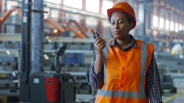 Thumbnail for Black Female Factory Worker Talking on Radio Set