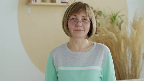 Smiling Middle Aged Mature Woman Looking at Camera Having Confident Happy Facial Expression