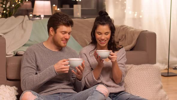 Thumbnail for Happy Couple Drinking Hot Chocolate at Home