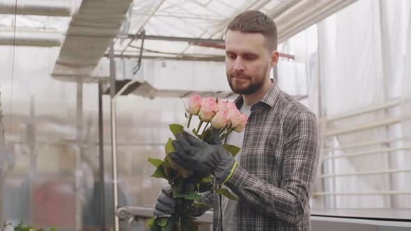 Thumbnail for Portrait of Man with Flowers in Industrial Glasshouse