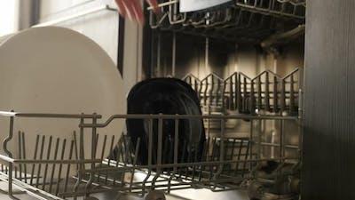Table dishware  inside built-in dishwasher  4K 2160p 30fps UltraHD footage - Modern dish washing mac