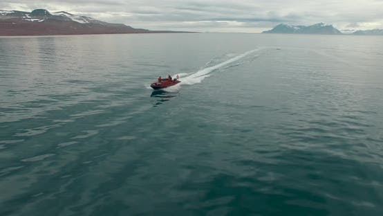 Thumbnail for A Person Aboard a Motorboat Speeding Through the Icy Water of the Arctic Ocean. Spitsbergen