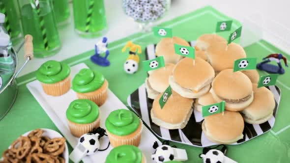 Thumbnail for Kids football party set with snacks and drinks.