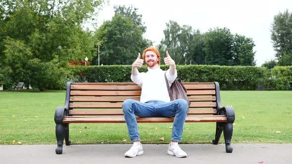 Thumbnail for Happy Redhead Man Gesture of Thumbs Up in Park