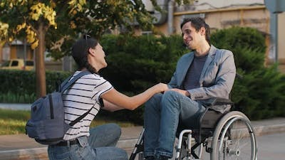 Supporting a Man in a Wheelchair